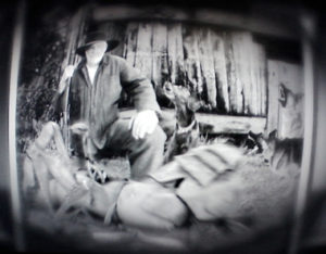 Photo of Akeley with dead creature