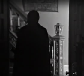 A dark figure is glimpsed one night in the front hall.