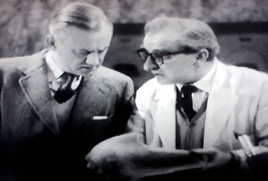 Quatermass and Dr. Pugh examine the so-called meteorite