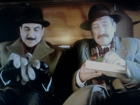 Poirot and Japp exchange gifts