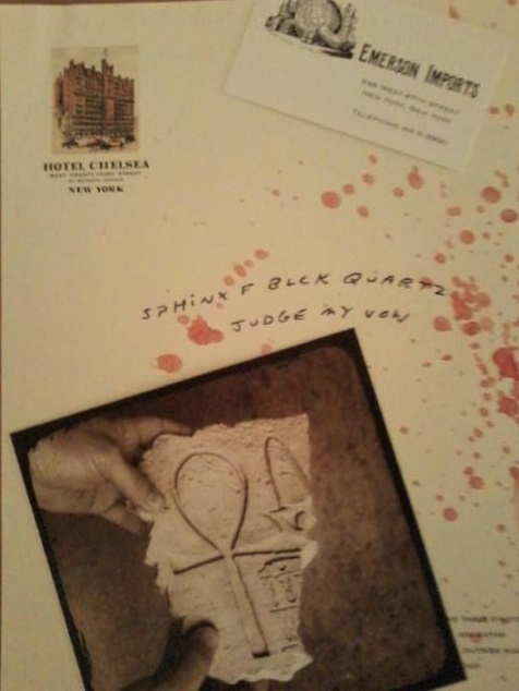 Props: blood-spattered cryptic note and photo of an Ankh